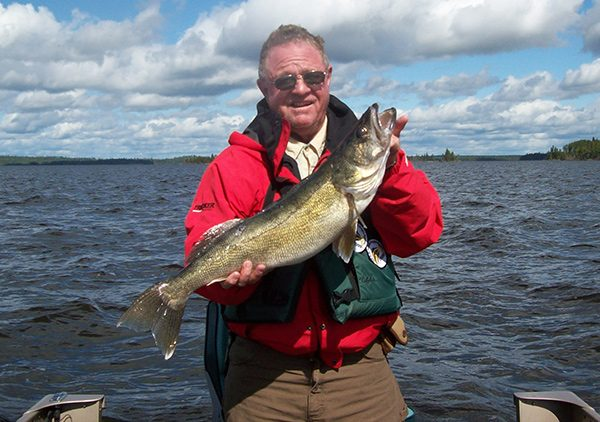 Fisherman Holding Giant Walleye He Just Caught Aspect Ratio 600 422