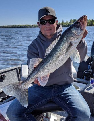 Guest Holding Giant Walleye Catch Aspect Ratio 330 422