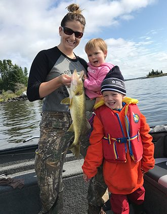 Mom And Kids Showing Their Walleye Fishing Catch Aspect Ratio 330 422